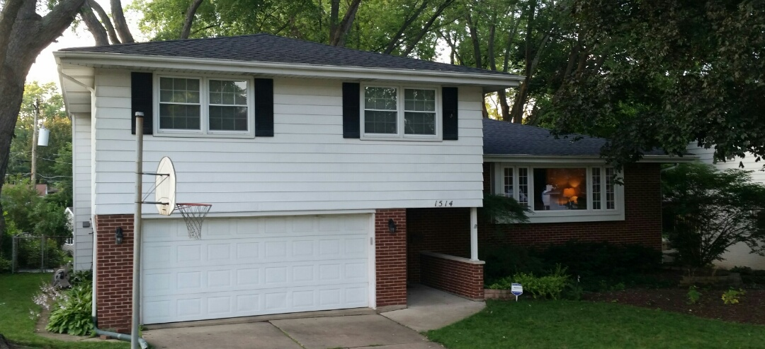 Arlington Heights, IL - Completed roof installation with CertainTeed Landmark Architectural shingles- Color: Moire Black