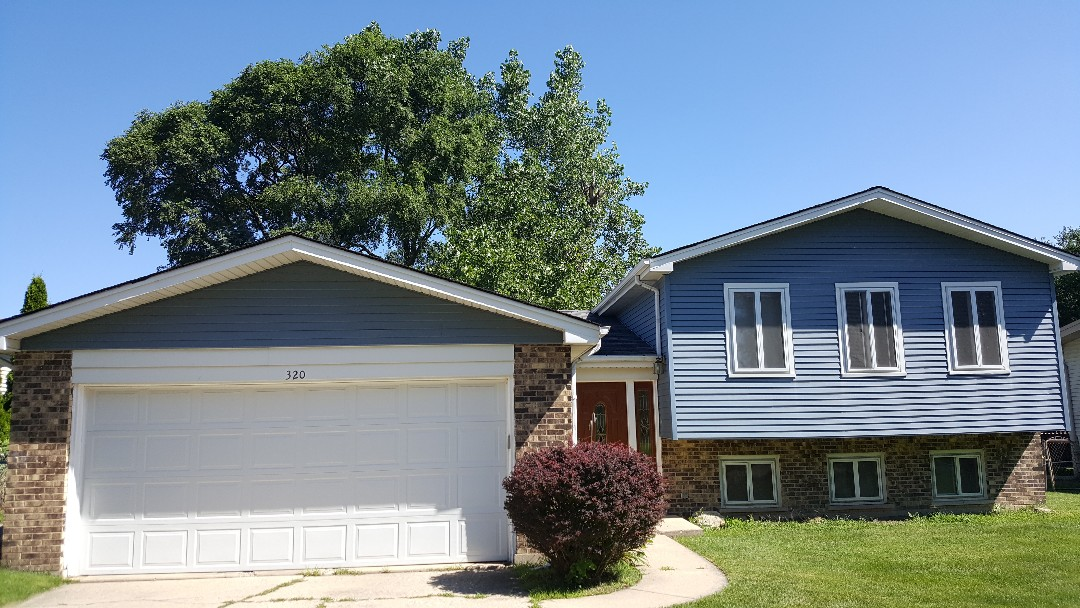 Schaumburg, IL - Complete roof tear off and repair estimate for tree damage