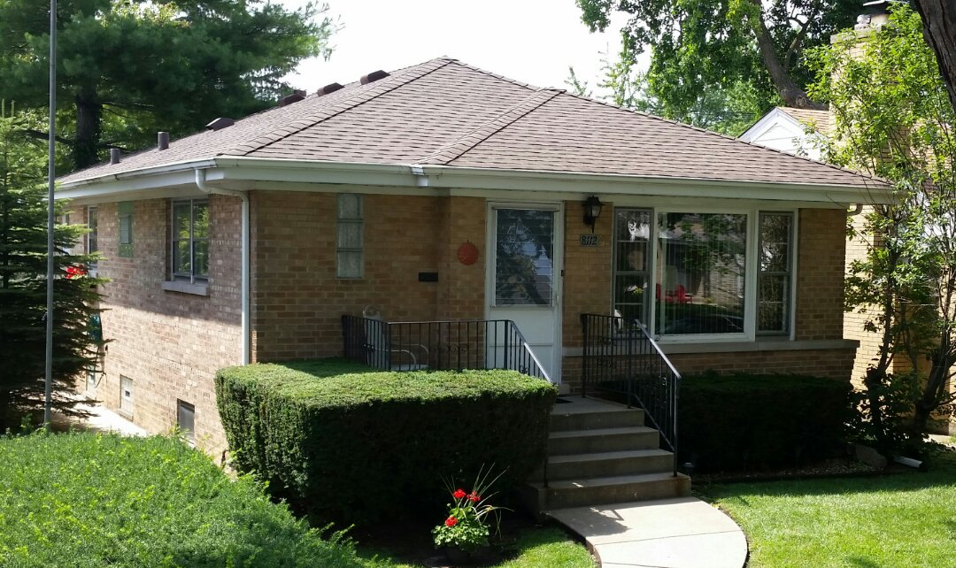 Skokie, IL - Roof installation completed using GAF Timberline lifetime Architectural shingles.  COLOR: Barkwood