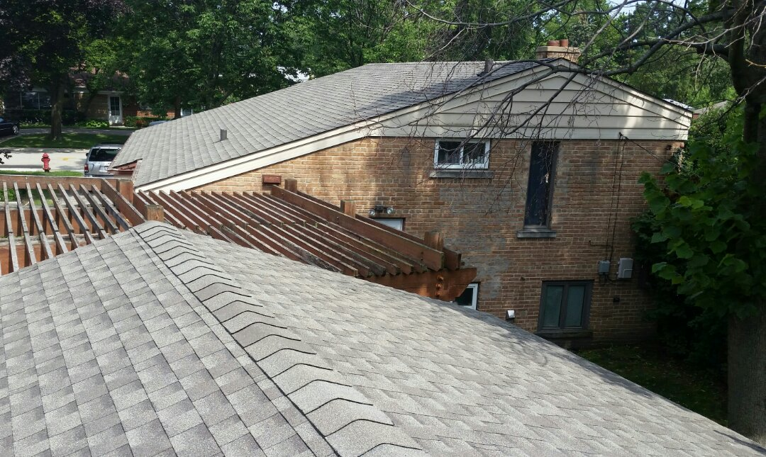 Lincolnwood, IL - Roof Installation completed using GAF Timberline lifetime Architectural shingles.  COLOR: Weathered Wood