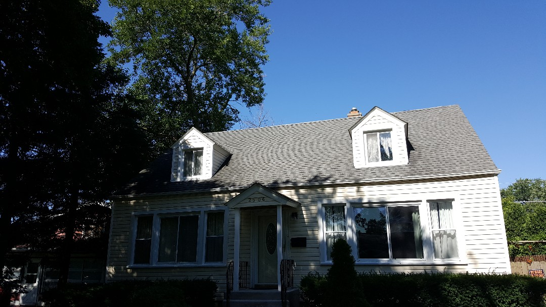 Dormer siding and shingle roof repair