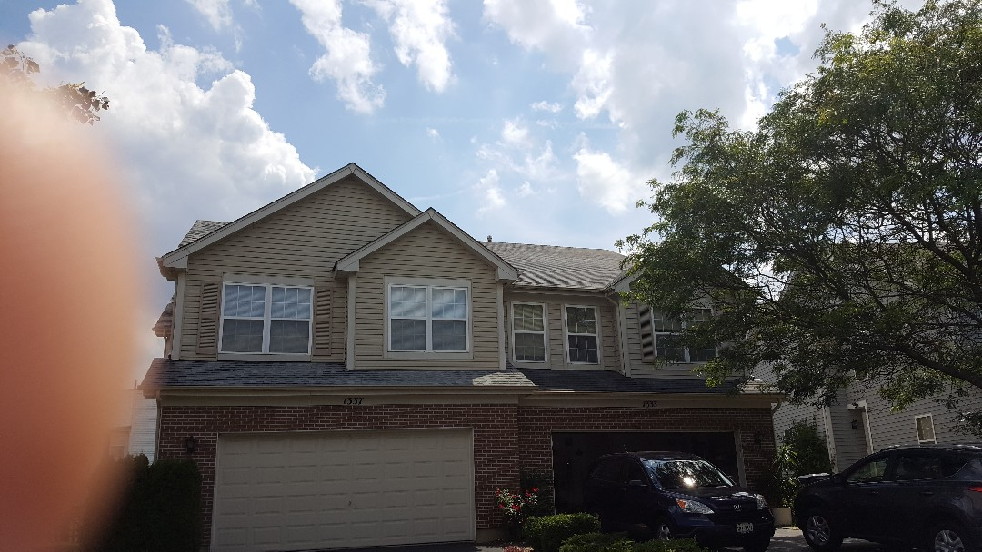 Storm shingle damage and full shingle roof replacement