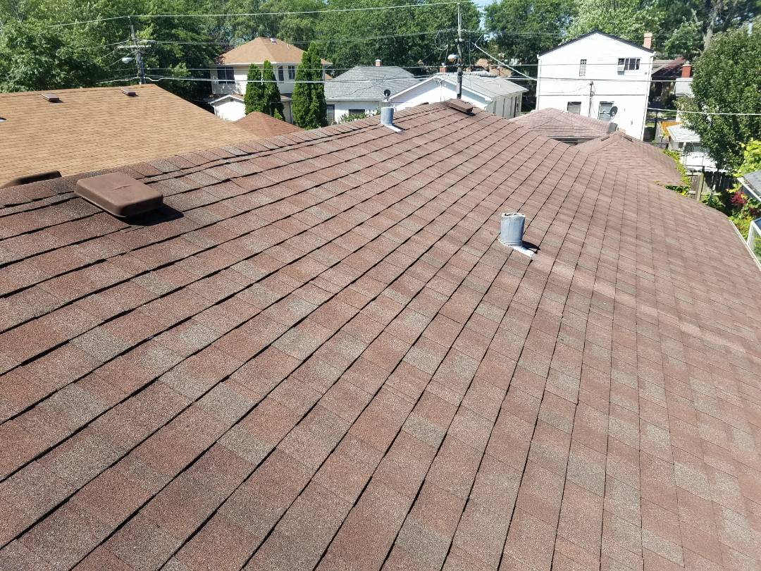 Schaumburg, IL - Estimating asphalt shingle roof for hail damage checking siding and gutters also for Hail and wind damage
