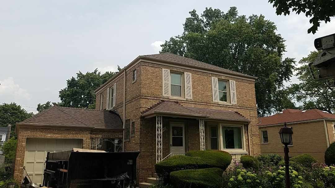 Skokie, IL - Checking in on job site almost complete with a asphalt shingle Landmark AR CertainTeed Heather blend roof