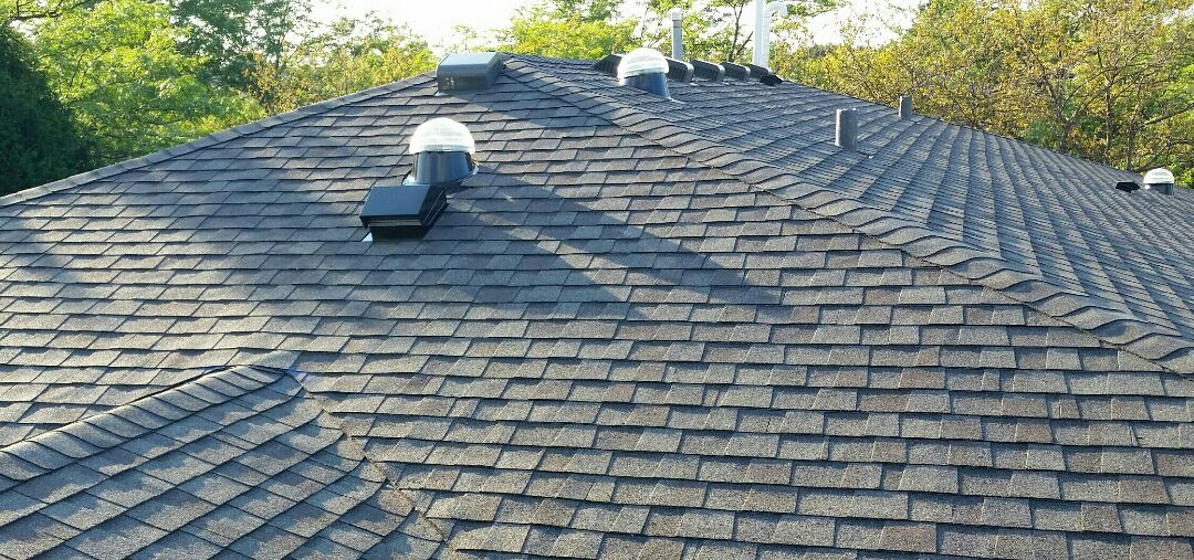 Deerfield, IL - Roof replacement completed.  Installation of CertainTeed landmark architectural shingles.  Color: Weathered Wood. Also, installation of four (4) Solatubes.