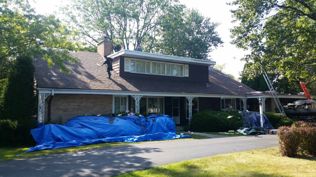 Installation of new roof in progress.