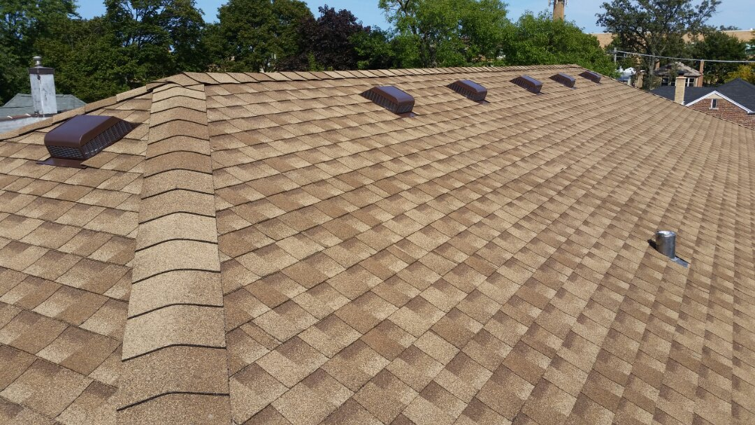 Roof replacement with GAF Timberline Architectural shingles. Color: Shakewood