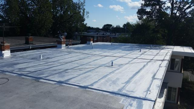 Completed flat roof project using modified bitumen roofing system.