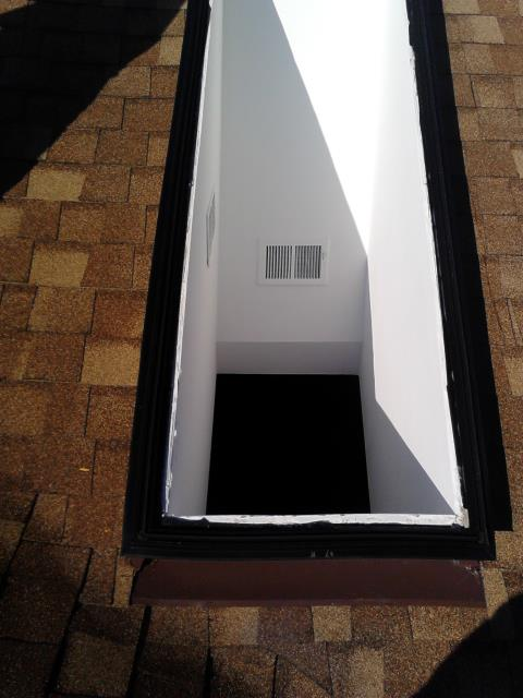 Removing a defective skylight.