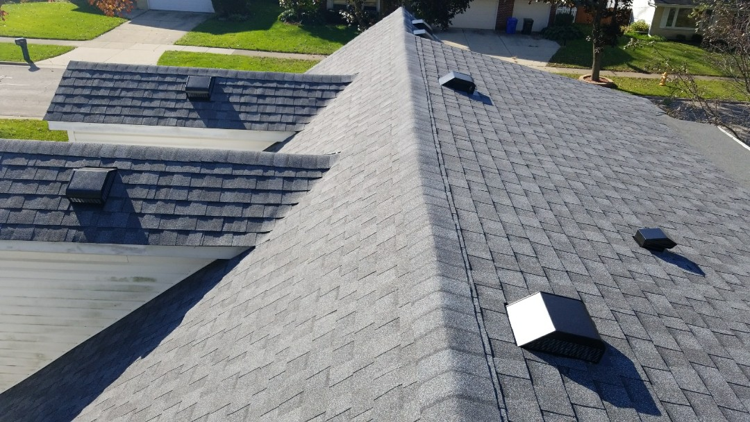 Inspecting roof for final close out. We installed asphalt shingles certainteed landmark AR and new plywood