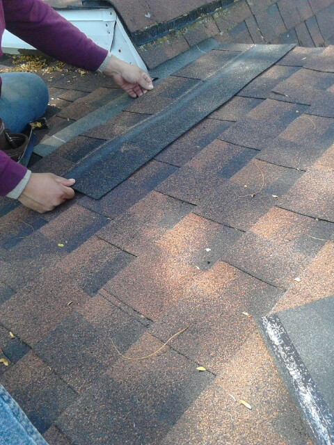 Doing a shingle roof repair on dead valley.