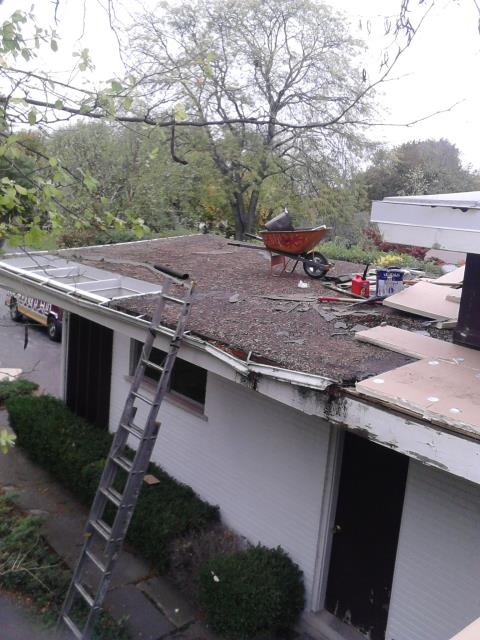Setting up to tear off flat roof and install new modified bitumen roofing system.