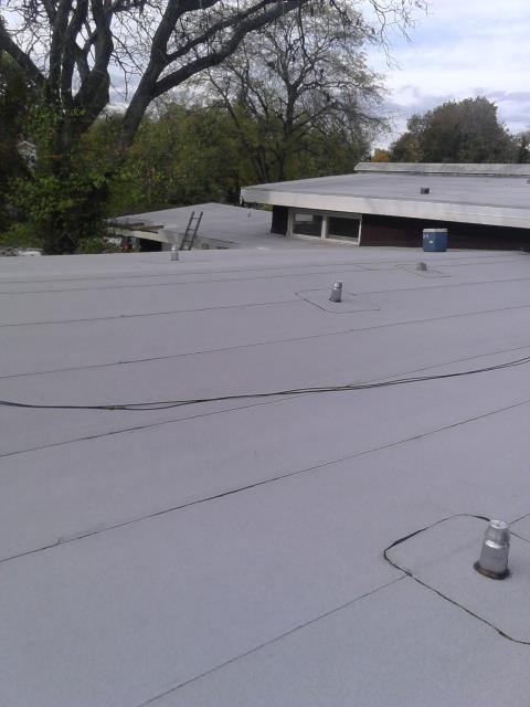 Finished modified bitumen roofing system.