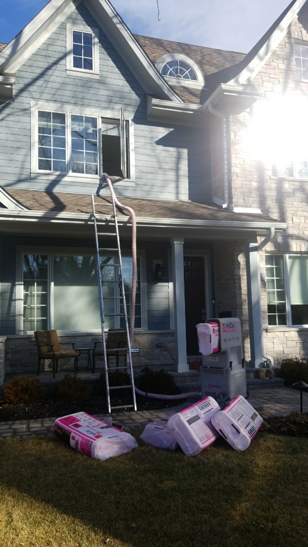 Northbrook, IL - Installing Owen's Corning Attica blow in insulation.