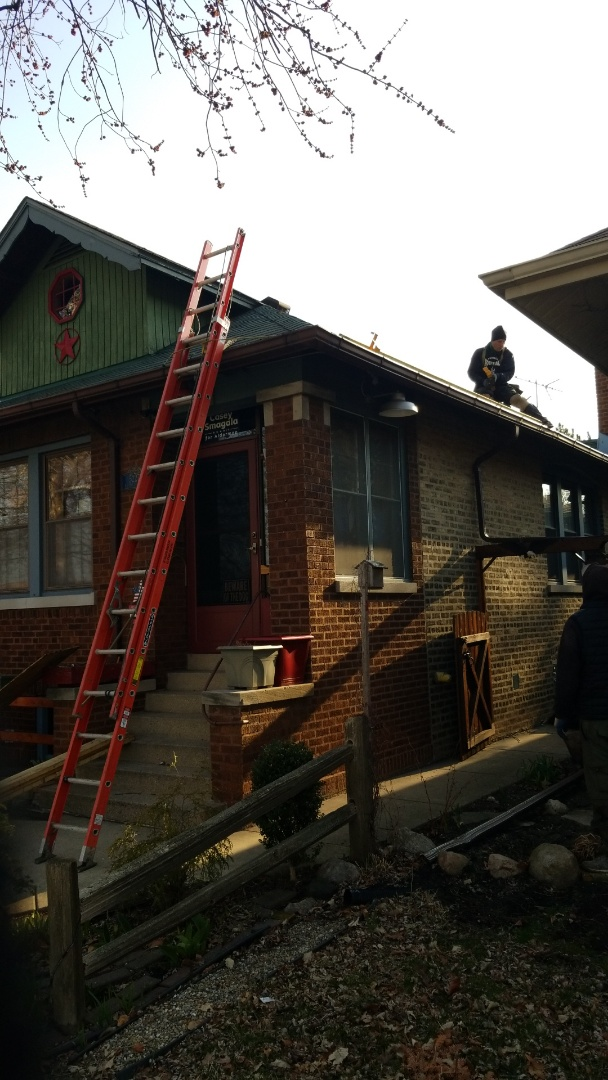 Chicago, IL - Setting up for a full roof tear off installing GAF timberline HD shingles