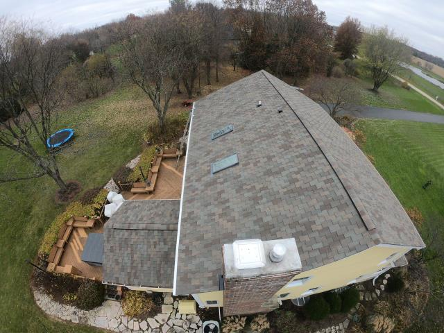 St. Charles, IL - New Roof, Gutters and Skylights installed on this beautiful home
