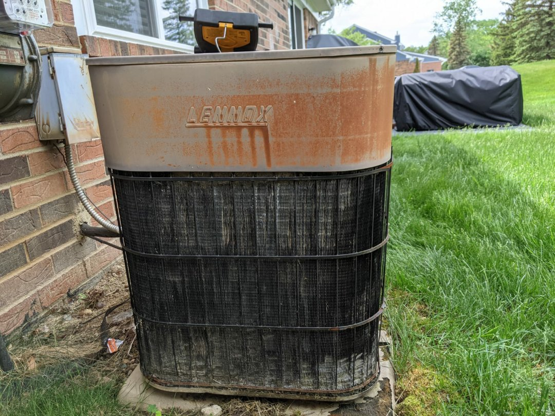 West Bloomfield Township, MI - Lennox condenser unit. Poor condition needs replacement.