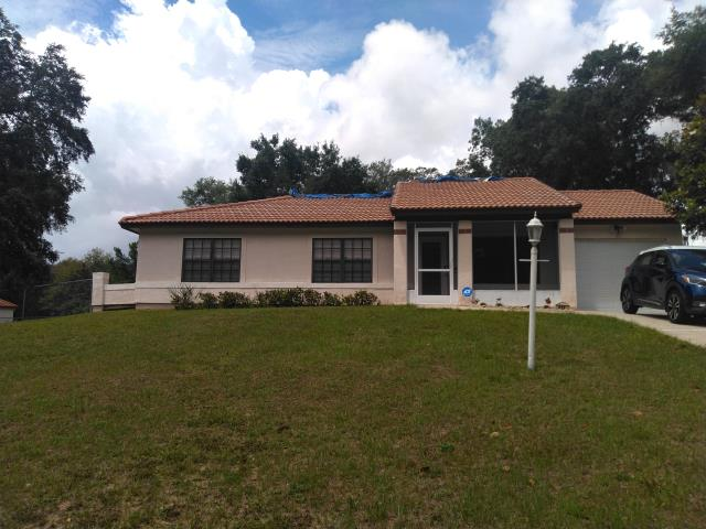 Ocala, FL - Remove old Plywood and Shingle replace with new plywood and GAF Timberline HDZ Weathered Wood Shingle Install half-lapped GAF Feltbusters underlayment to building code specifications. Install new Bullet Boot Shields on all plumbing projections. Install new Weatherwatch IWS in all valleys. Install 1.75 face Aluminum eave drip. A Lifetime Warranty to be issued by manufacturer.