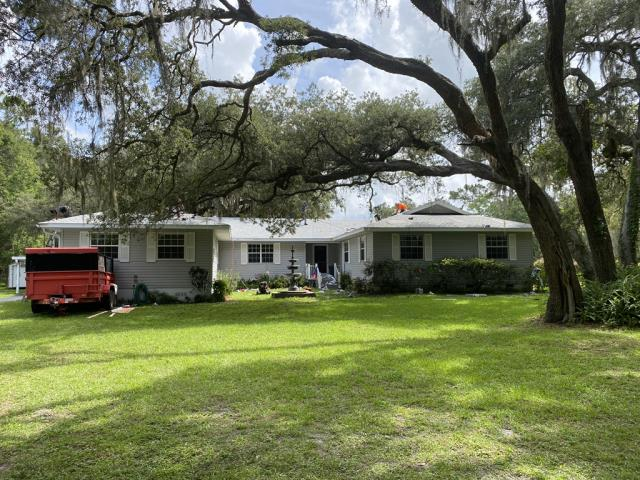 Summerfield, FL - Remove old Plywood and Shingle replace with new plywood and GAF Timberline HDZ Birchwood Shingle Install half-lapped GAF Feltbusters underlayment to building code specifications. Install new Bullet Boot Shields on all plumbing projections. Install new Weatherwatch IWS in all valleys. Install 1.75 face Aluminum eave drip. A Lifetime Warranty to be issued by manufacturer.