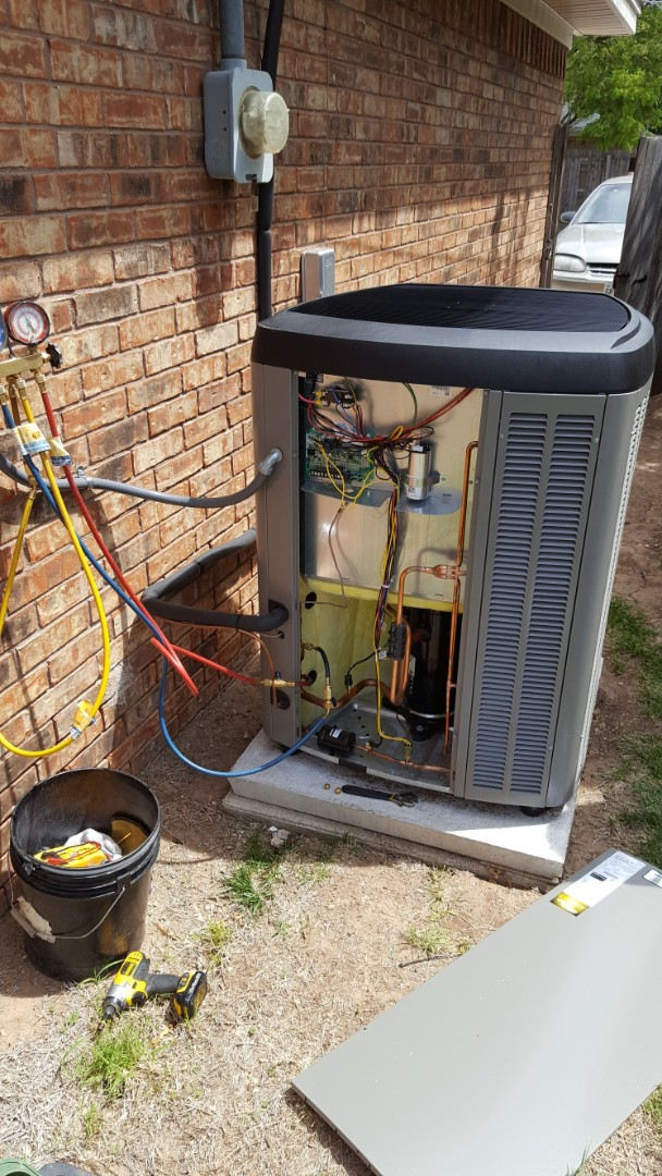 Amarillo, TX - AC cooling system check on a high efficiency Lennox Air conditioner.