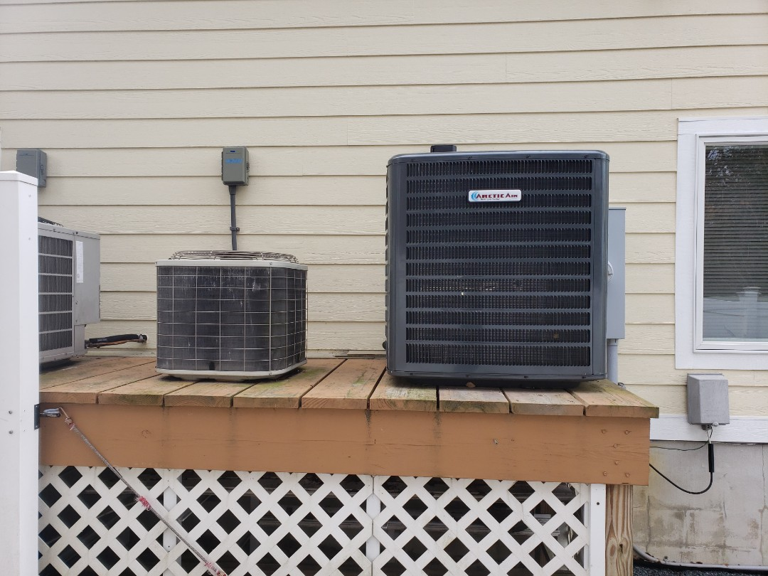 Berlin, MD - Installing a new 16 seer Arctic Air heat pump system in a single family home in Berlin Maryland in the Ocean Reef community