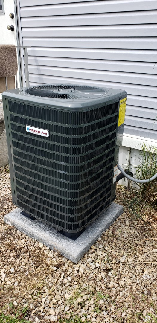 Selbyville, DE - Installing Arctic air heat pump in Swan keys De.