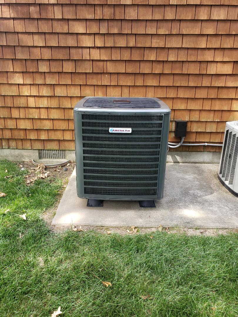 Rehoboth Beach, DE - Installing a new 18 seer Arctic Air heat pump in a single family residence in Rehobeth DE in the Canal Corkran development.