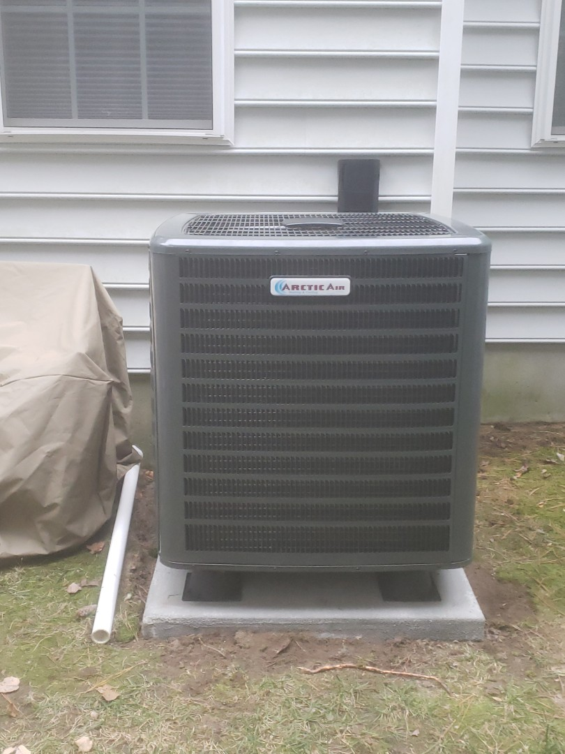 Ocean Pines, MD - Installing a new Arctic Air heatpump system in a multi family residence in Ocean Pines MD