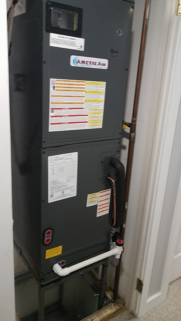 Completing installation of Arctic Air heat pump system for a family in ocean city at North Point