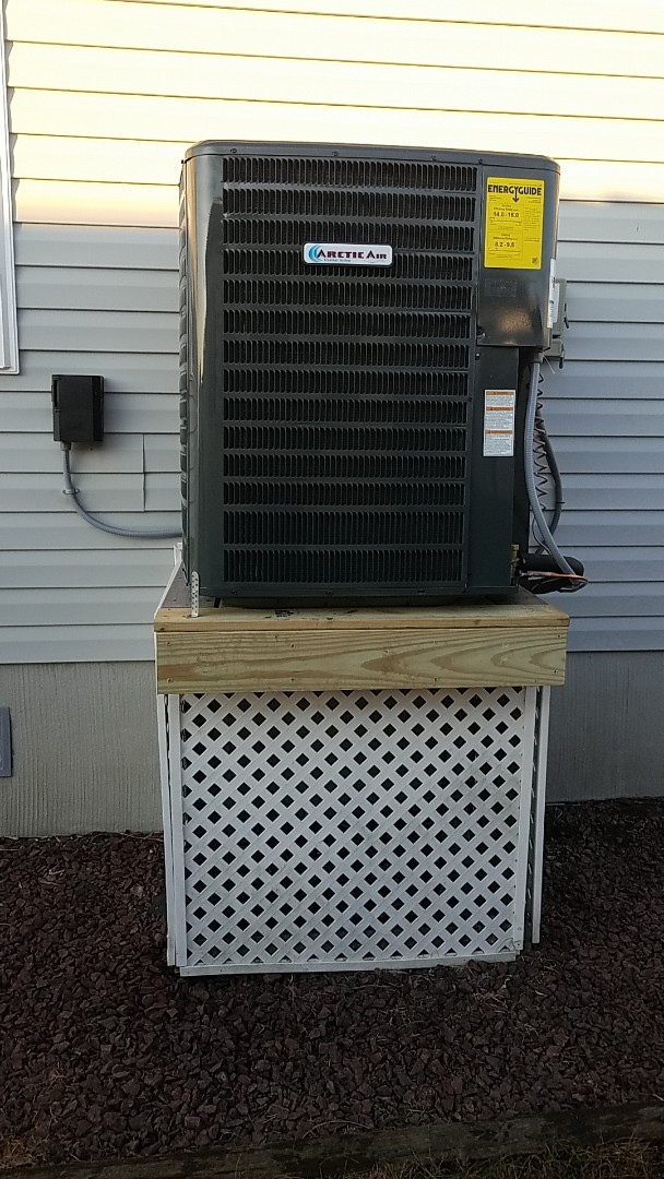 Ocean City, MD - Completing installation of Arctic Air heat pump system for a family in ocean city at montego bay