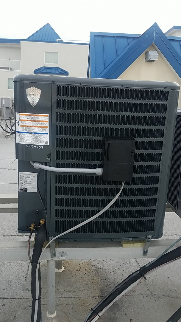 Ocean City, MD - Completing installation of Arctic Air heat pump system for a family in Ocean City at Purnell House