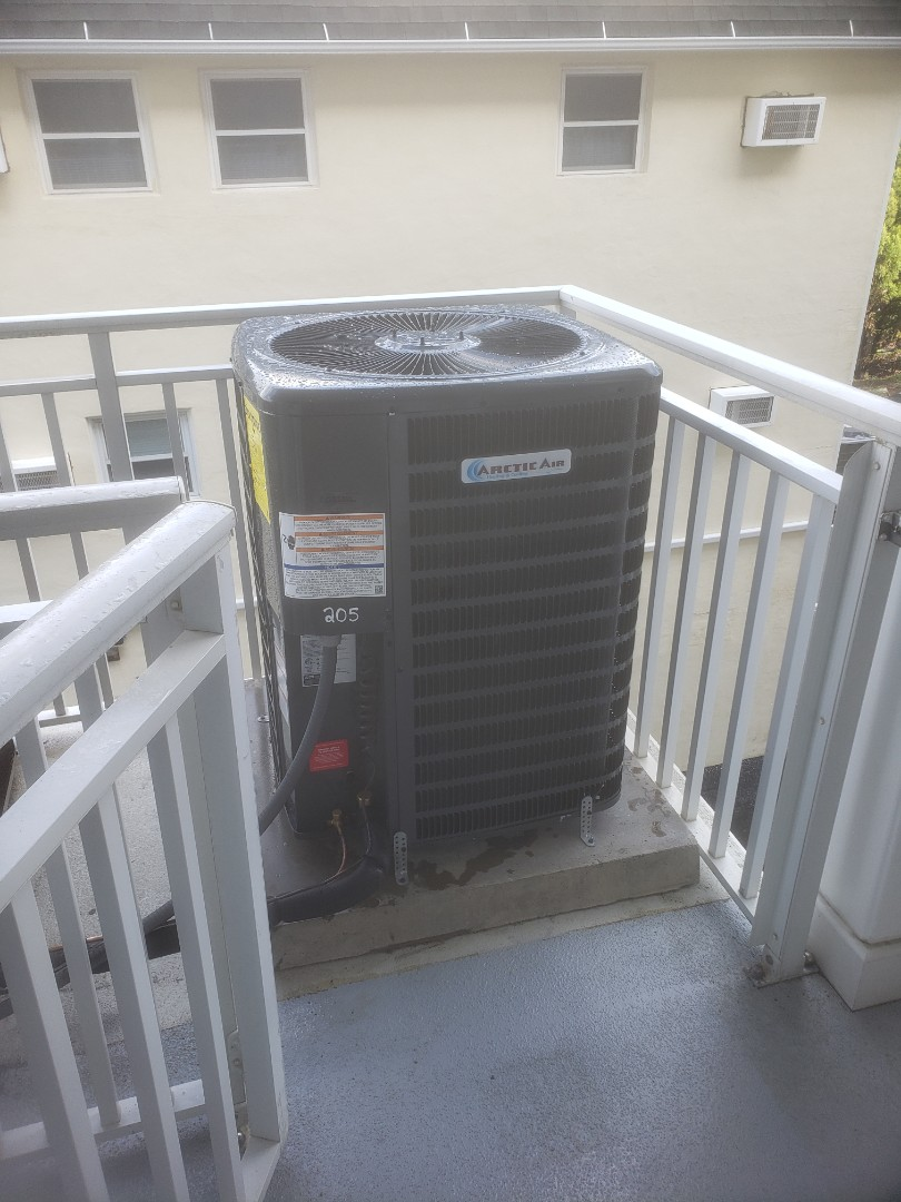 Ocean City, MD - Installing a new Arctic Air heatpump system in a multi family residence in Ocean City MD at the 1400 building