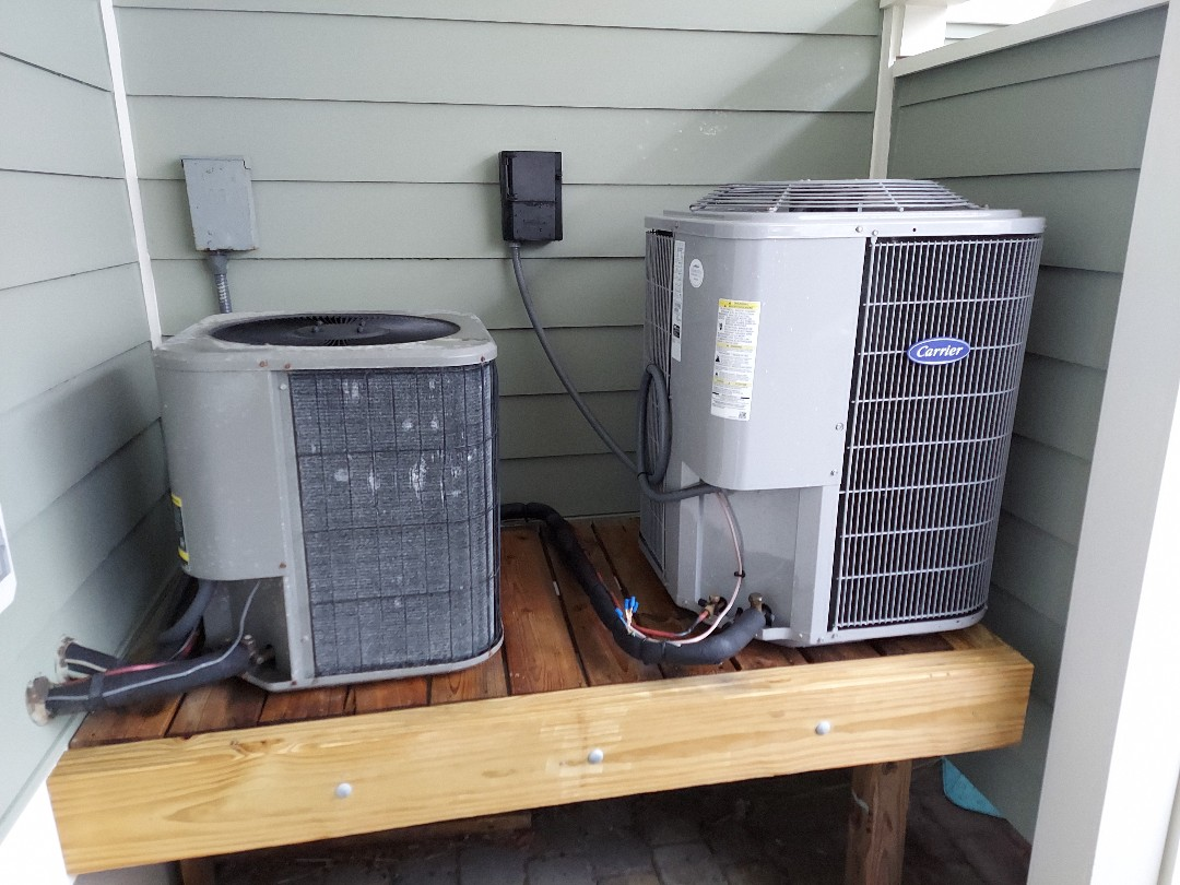 Doing a double Ac tune up on a lennox straight ac and a carrier heat pump in sunset island ocean city md