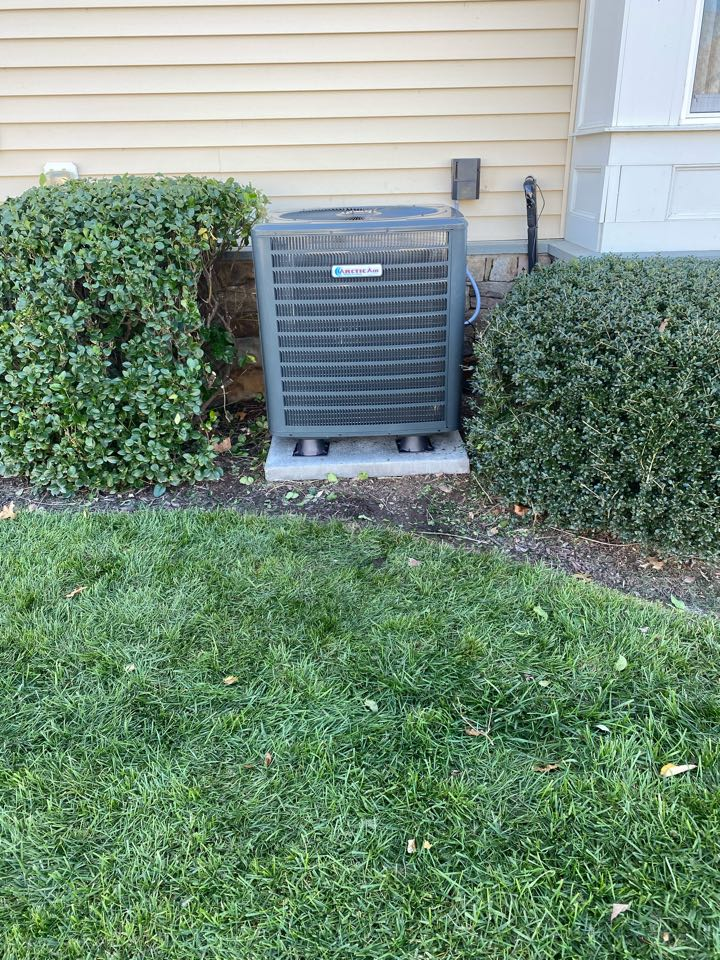 Installing a new 16 seer Arctic Air heat pump system in a residential neighborhood