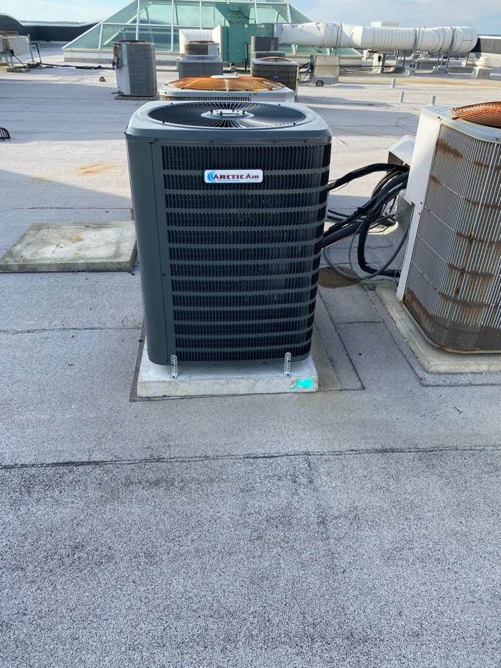 Installing a new Arctic Air heat pump system in a multi family condo in Ocean City MD at the South Beach