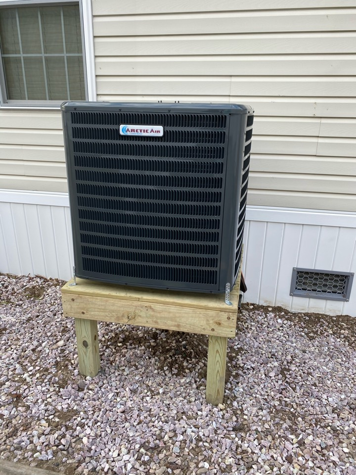 Installing a new 16 seer Arctic Air heat pump system in a single family community in Ocean City MD