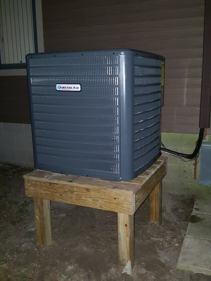 Millsboro, DE - Completing installation of Arctic Air heat pump system for a family in Millsboro DE