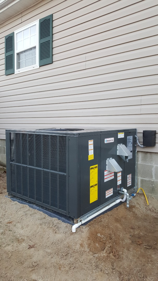 Berlin, MD - Completing installation of Arctic Air Duel fuel heat pump/furnace package unit for a family in Berlin