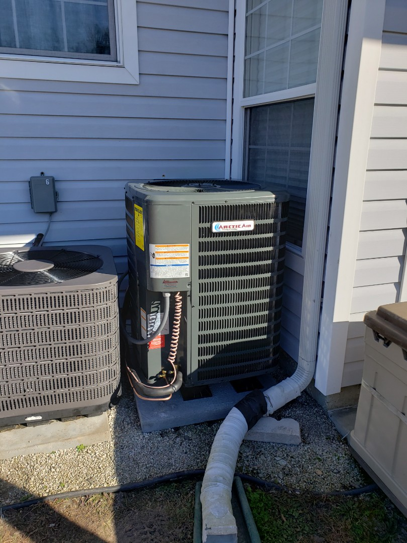Berlin, MD - Installing a new 14 seer Arctic Air heatpump system in a multi family development in Ocean Pines MD