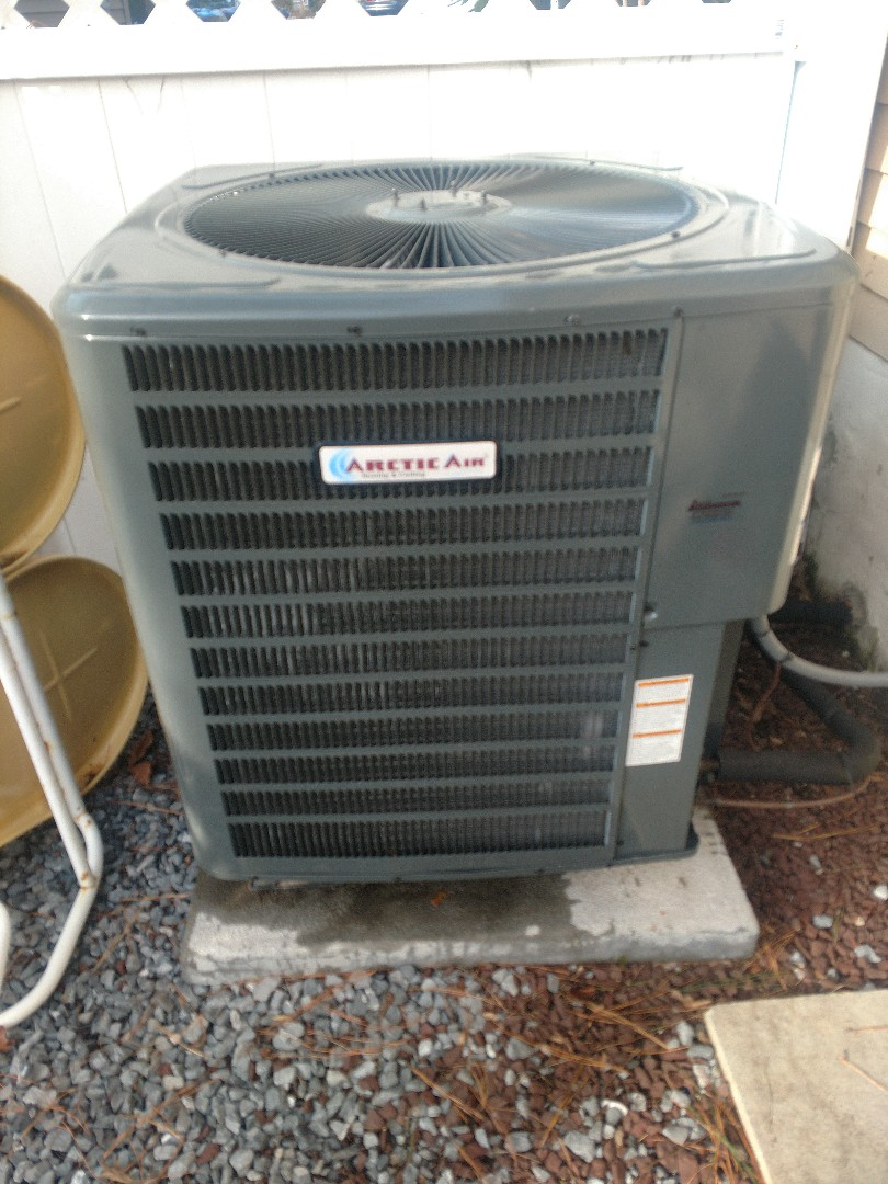 Ocean Pines, MD - Performing maintenance on an Arctic Air heat pump for a couple in Ocean Pines.