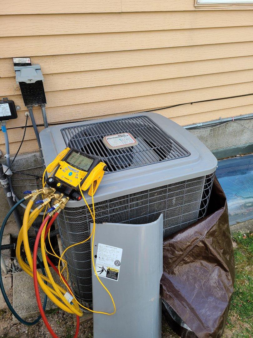 Salt Lake City, UT - Air conditioner tuneup on Heil air conditioner
