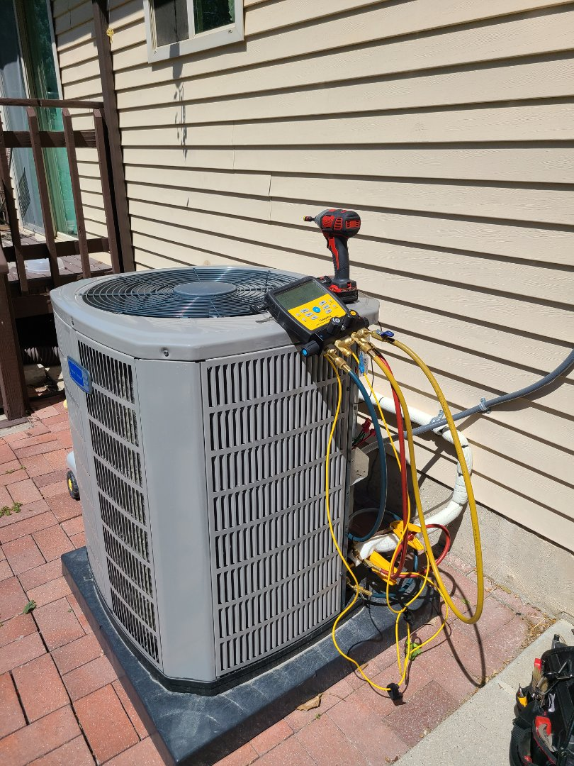 Sandy, UT - Air conditioning tuneup on American Standard air conditioner