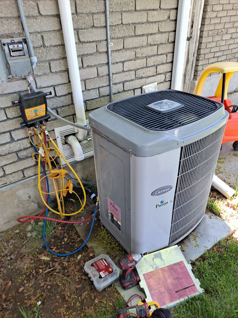 Murray, UT - Air conditioner tune-up on Carrier Air conditioner