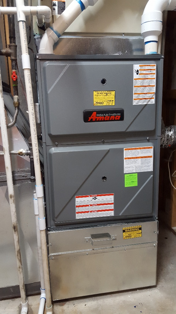 North Salt Lake, UT - New amana high efficiency furnace installed on base for better airflow. Existing air conditioning.