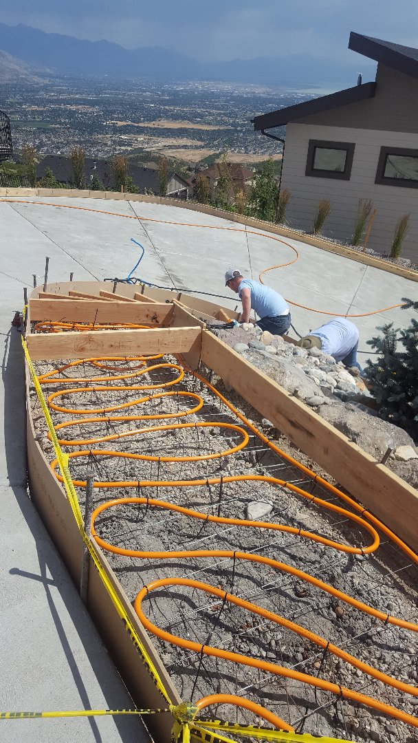 Draper, UT - Laying radiant tube in stairs for snow melt system.