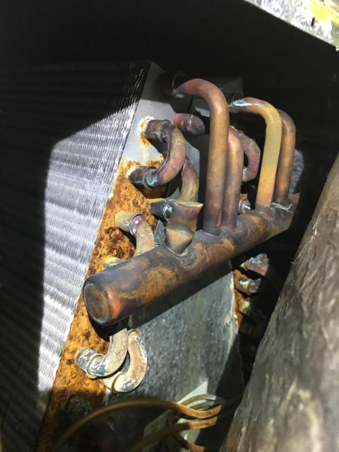 Alpharetta, GA - 1 system a/c prepaid preventative maintenance. Replaced filter, cleared drain and clean condenser coil. Found rusty coil, low on freon and weak hard start kit. Added 2 lbs of freon to the system, replaced hard start kit and added leak seal to the system. the system is cooling at this time