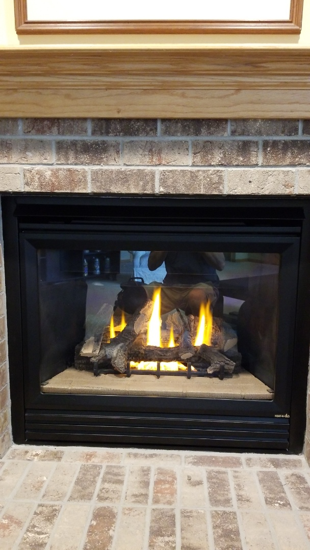 Newport, MN - Heat N Glo gas fireplace service