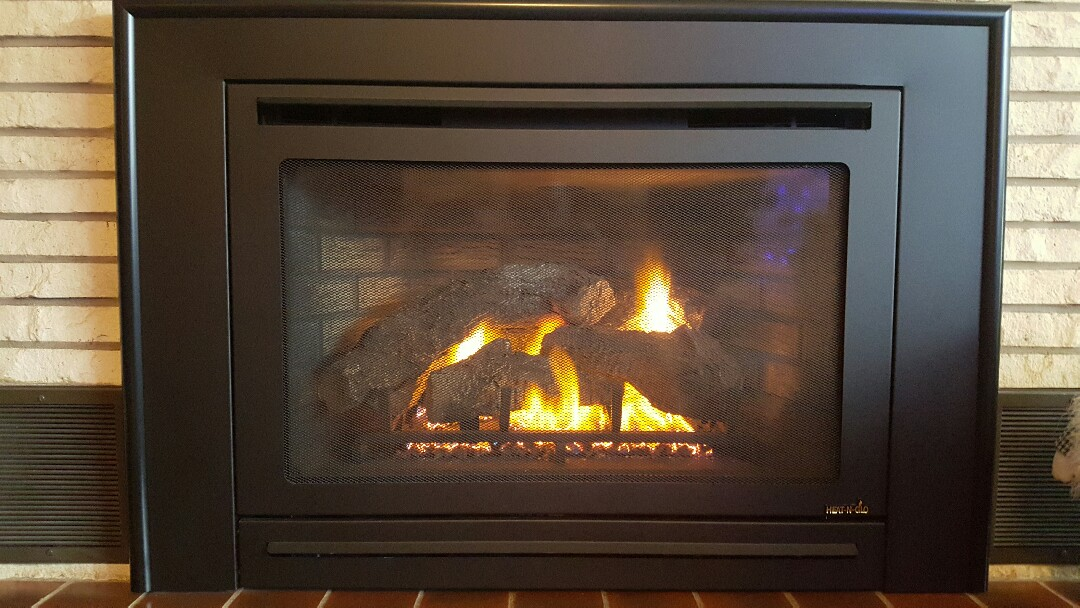 Plum City, WI - Cleaned and repaired a heat-n-glo fireplace