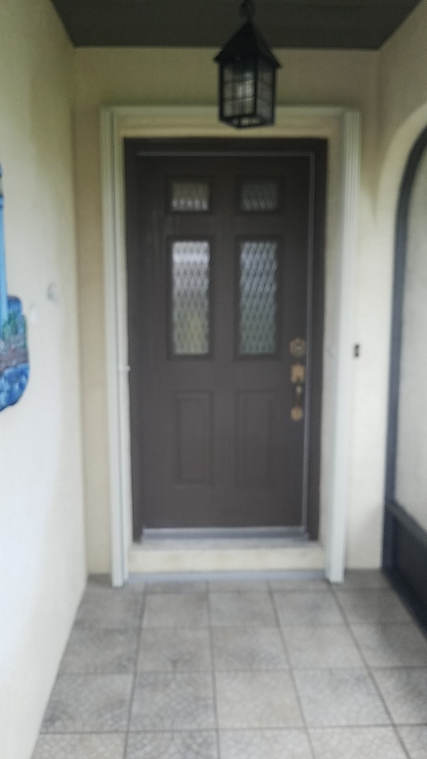 Installed accordion shutter front entry way recessed track