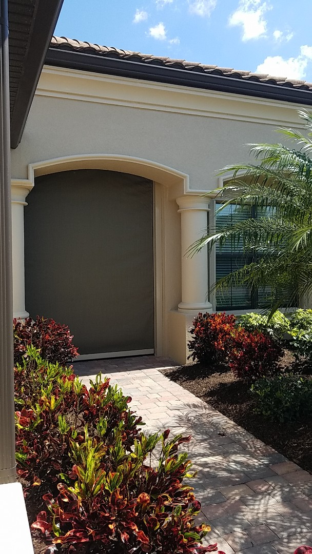 Installed hurricane accordion shutters and hurricane fabric roll downs